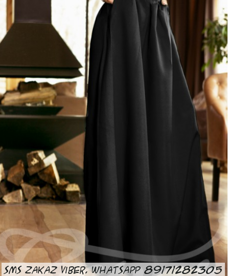 Черная длинная юбка с карманами